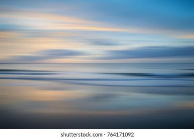 Stunning long exposure blur sunrise landsdcape of idyllic Broadhaven Bay beach on Pembrokeshire Coast in Wales