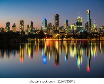 The stunning Melbourne skyline reflected in Albert Park Lake.