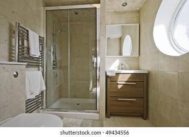 stunning modern en-suite bathroom with shower cabin