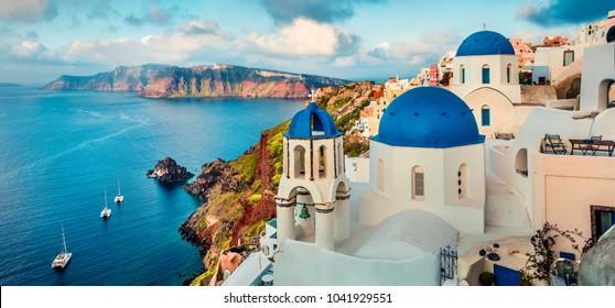 Stunning morning panorama of Santorini island. Splendid spring sunrise on famous Greek resort Oia, Greece, Europe. Traveling concept background. Artistic style post processed photo.