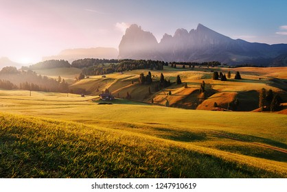 Stunning morning Scene. Majestic Moutain peak under sunlight, Alpe di Siusi valley during sunset. Amazing Nature Landscape. Awesome natural Background. Incredible colorful Scenery. Dolomites alps
