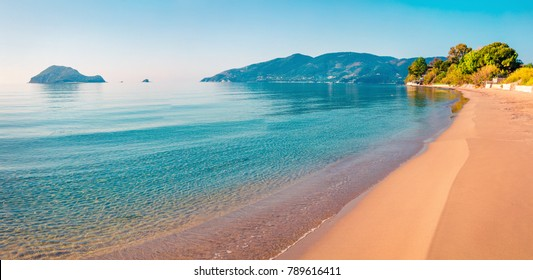 Stunning morning view of beach of Zakynthos (Zante) island. Sunny spring seascape of the Ionian Sea, Greece, Europe. Beauty of nature concept background.