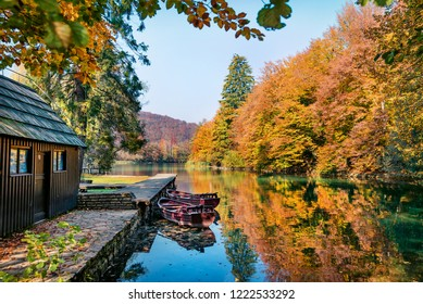 Stunning morning view of pure water lake with boats in Plitvice National Park. Amazing autumn scene of Croatia, Europe. Beauty of nature concept background.