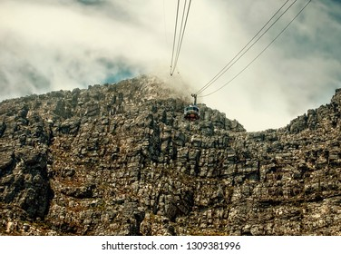 Stunning mountain landscape. Tourists climb up to the top of a mountain with a help of a cable way. Nature. Up in the clouds. Awesome view of a mountain top.