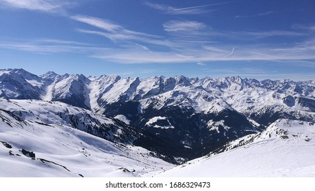 A stunning mountain panorama from the top of a mountain in Austria on a sunny day.
