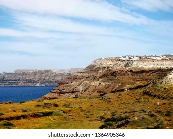 Stunning natural landscape and seascape on Santorini Island, one of most famous Aegean Islands with island, colorful cliff, blue sky, artistry cloud, and peaceful ocean. Travel destination in Greece.