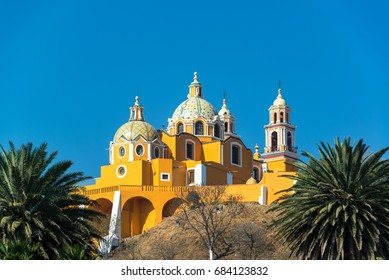 Stunning Our Lady of Remedies church and palm trees in Cholula, Mexico