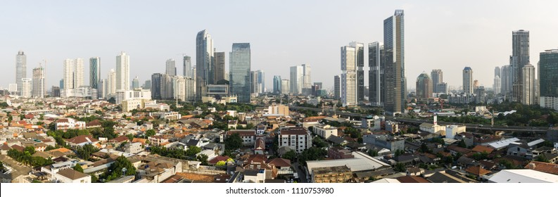 Stunning panorama of Jakarta South Central Business district contrasting with low rise residential middle class housing area in Indonesia capital city in Southeast Asia