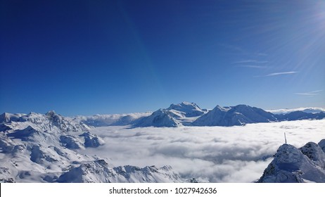 Stunning panorama from Mont-Fort, Verbier, Valais, Switzerland on a clear bright winter day. Rosablanche, sea of clouds over Val de Bagnes, Grand Combin and Combin de Corbassière.