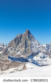 Stunning panorama view of famous Matterhorn, Weisshorn and Pennine Alps on Swiss Italien border on sunny autumn day with snow and blue sky, from Klein Matterhorn, Glacier Paradise, Valais, Switzerland