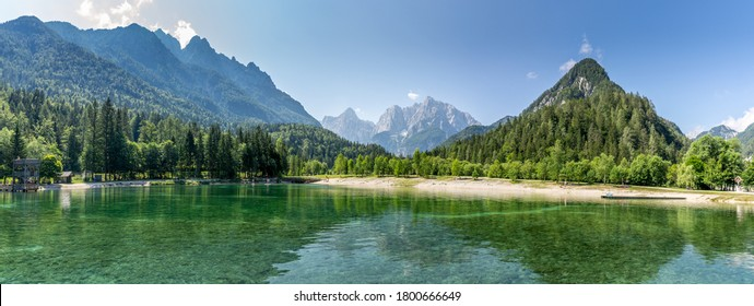 Stunning panorama view over Lake Jasna, Kranjska Gora, Slovenia, with the Alps in the background.