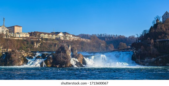 Stunning panorama view of the Rhine Falls, the most powerful waterfall in Europe on the High Rhine river, on sunny autumn day with blue sky cloud in background, Schaffhausen, Switzerland
