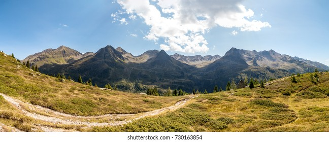 Stunning Panorama of the Villgratner Berge mountain range at the Austrian border to Italy, inclusing the Pfannhorn, rote Wand and Edelweissknopf mountains, as seen from the slope of the Ohrenspitzen.