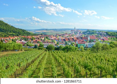 Stunning panoramic landscape with rows of vineyards around beautiful Czech city Mikulov with dominant Mikulov Castle. Located in Moravia region, which is mainly in summer a popular tourist destination