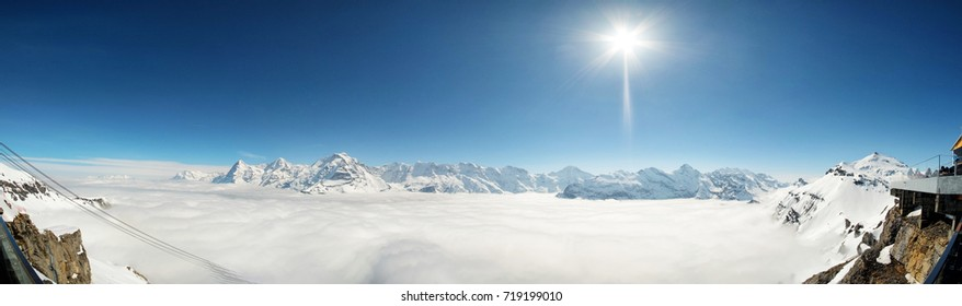 Stunning Panoramic view Snow moutain of the Swiss Skyline from Piz Gloria Schilthorn, Switzerland