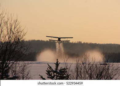 Stunning photo flight of the aircraft in the winter woods on a background of forest and snow, Russia