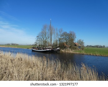 stunning Photo from two dutch barges mooring in dutch landscape.  2 little houses, reed, trees