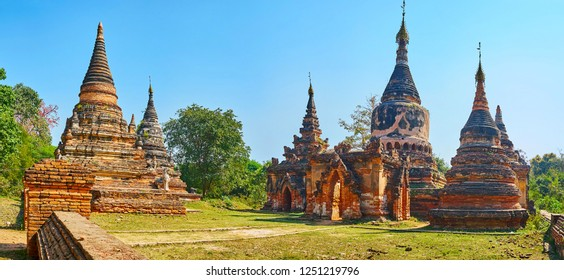 The stunning red stupas of Daw Gyan Pagoda with ringing hti umbrellas and preserved decorations, Ava (Inwa), Myanmar.
