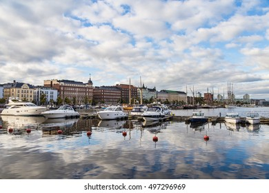 Stunning reflection of Pohjoissatama harbour, a marina with many luxury yachts and old boats, in Helsinki, Finland capital city.