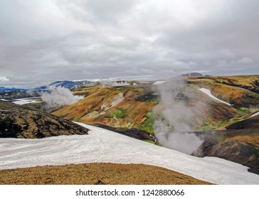 Stunning rhyolite mountains wrapped in geothermal steam, located in the Landmannalaugar, Fjallabak Nature Reserve, central Iceland