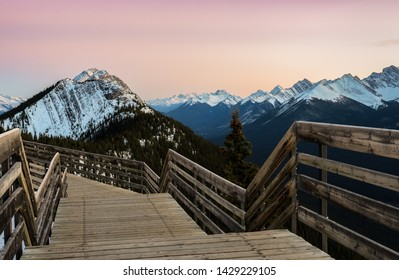 Stunning rocky mountains twilight scene of boardwalk on Sulphur Mountain connect to Gondola landing in Banff, Canada. Gondola ride to Sulphur Moutain overlooks the Bow Valley and the town of Banff.