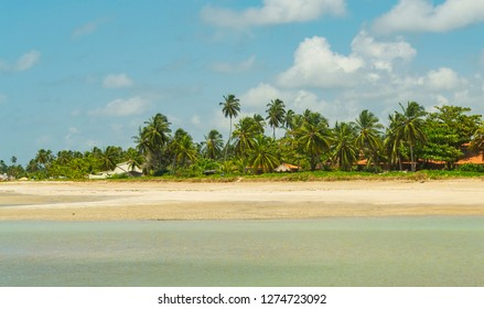 Stunning scenery of the beach of Porto da Rua, Sao Miguel dos Milagres, Alagoas, with low tide, turquoise blue sea, boats and tourists.