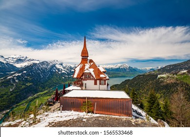 Stunning scenery with mountain hut on top Harder Kulm summit - popular tourist attraction over Interlaken. Breathtaking view on Lake Thun and Swiss Alps. Berner Oberland, Switzerland