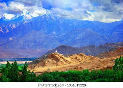 Stunning scenic view of Shanti Stupa (Peace Pagoda) on the top of sandy hill against the background of Himalaya moumtains and blue sky in Leh, Ladakh range, Jammu & Kashmir, Northern India, Asia