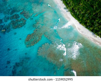 A stunning shot of the edge of a lone island off the coast of Samoa, Pacific Ocean.