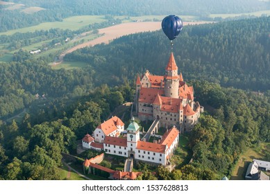 Stunning shot of hot air ballon right above castle Bouzov, perfect for wallpaper