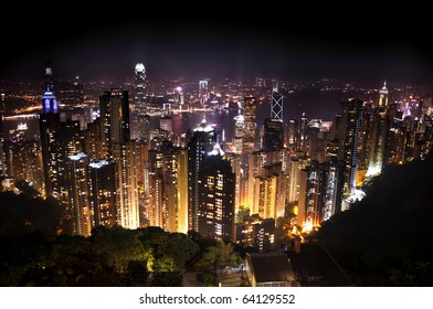 Stunning sightseeing of the skyscrapers of Hong Kong by night from the Victoria Peak.