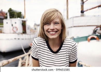 Stunning smiling blond woman, portrait