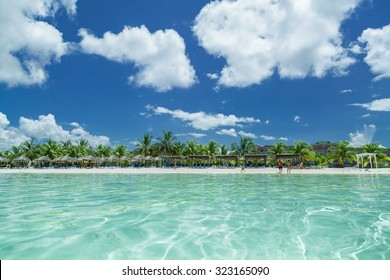 stunning splendid amazing inviting view of Cuban, Cayo Coco beach from the tranquil turquoise ocean side, with people in background