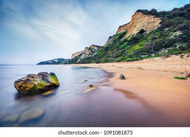 Stunning spring view of Gardeno beach. Dramatic morning seascape of Ionian Sea. Picturesque landscape of Corfu island, Greece, Europe. Traveling concept background.