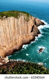 Stunning and steep cliff dominating the shore. The cliff  is composed of hundreds of hexagon-shape rocks.
