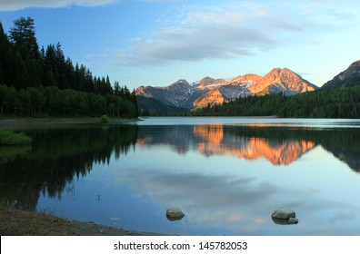 Stunning summer landscape with Mt. Timpanogos reflecting in Silver lake, Utah, USA.