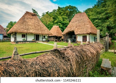 Stunning summer view of traditional romanian peasant houses. Wonderful rural scene of Transylvania, Romania, Europe. Beauty of countryside concept background.