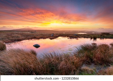 Stunning sunrise from Cleitreabhal a'Deas a hill in North Uist in the Western Isles of Scotland