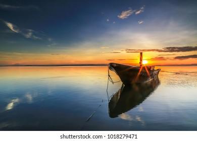 Stunning sunrise at with fishing boats, pillars and more at Labuan Tg Aru beach