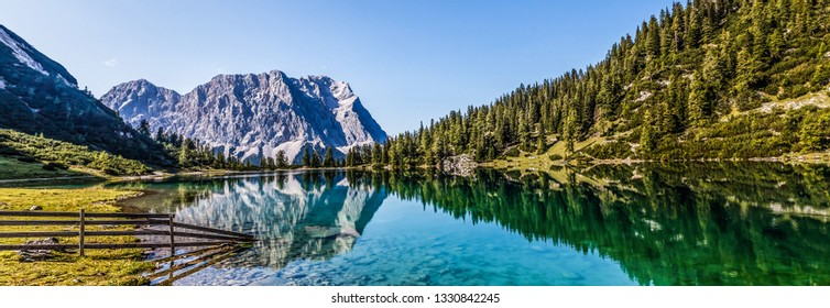Stunning sunrise at lake in the Mountains in summer