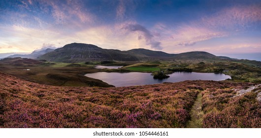 Stunning sunrise landscape over Cregennen Lakes with Cadair Idris in background in Snowdonia