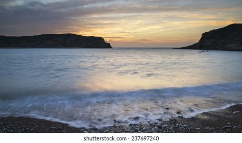 Stunning sunrise landscape over Lulworth Cove Jurassic Coast England