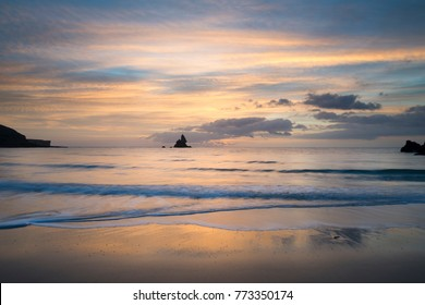 Stunning sunrise landsdcape of idyllic Broadhaven Bay beach on Pembrokeshire Coast in Wales