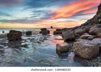 Stunning sunrise on the beach at Saltwick Bay on the North Yorkshire coast btween Whitby and Robin Hoods Bay