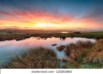 Stunning sunrise over peat bogs at North Uist in the Western Isles of Scotland