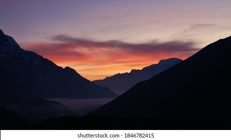 Stunning sunset with beautiful red and orange colored sky above the Himalayan mountains viewed from Dingboche, Khumbu region, Sagarmatha National Park, Himalayas, Nepal.