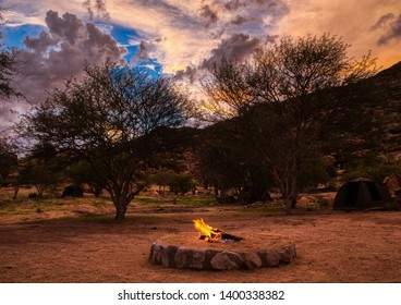 Stunning Sunset and a camp fire at the Erongo Mountains in northern Namibia during summer