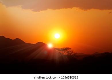 Stunning sunset in Kenya, Africa with dramatic sun flare