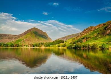 Stunning sunset at lake in District Lake, UK
