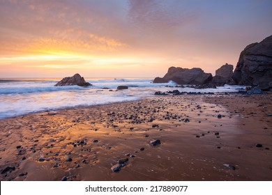 Stunning sunset on the beach at Sandymouth near Bude North Cornwall England UK Europe